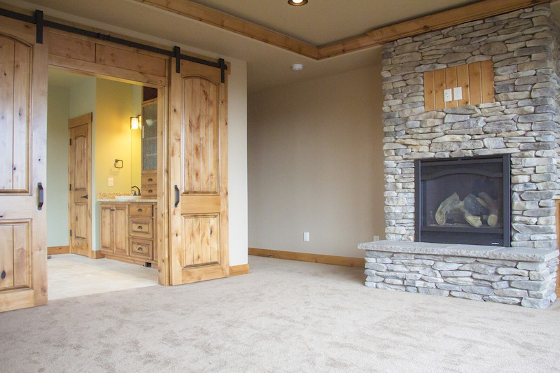 Master Bedroom with Custom Interior Barn Doors and Fireplace